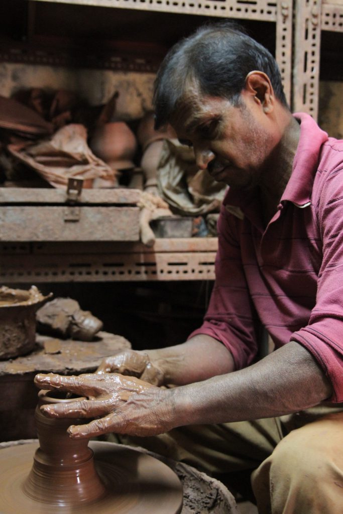 Dalit making wax candles